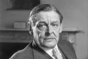 September 1958:  Portrait of American-born poet TS Eliot (1888 - 1965) sitting with a book and reading eyeglasses, around the time of his seventieth birthday.  (Photo by Express/Express/Getty Images)